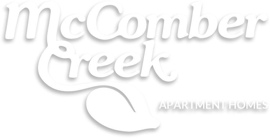 McComber Creek Apartment Homes logo